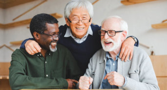 elderly men laughing
