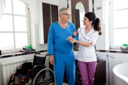 caregiver holding the elderly man