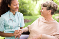 caregiver holding the elderly woman