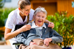 elderly woman and caregiver outdoors